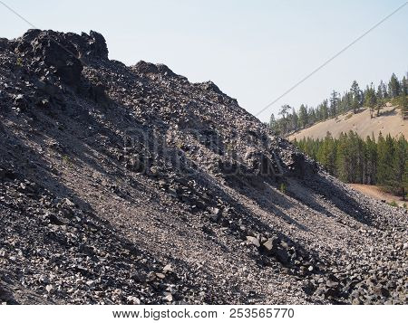 Textured Obsidian And Hardened Lava Rock On A Sunny Fall Day At The Big Obsidian Flow In The Newberr