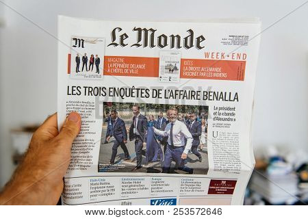 Paris, France - Jul 23, 2018: Man Hand Holding French Le Monde Newspaper Cover Page Reading About Th