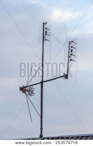 Satellite Tv House Antena With Cloudy Natural Background