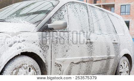 Car Wash With Foam In Car Wash Station. Carwash. Washing Machine At The Station. Car Washing Concept
