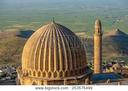 Minaret Of The Great Mosque Known Also As Ulu Cami With Mesopotamian Plain In The Background, Mardin