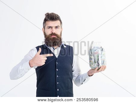 Portrait Of Serious Businessman Holds Jar With Money. Bank Advertising. Saving Money Concept. Bank C