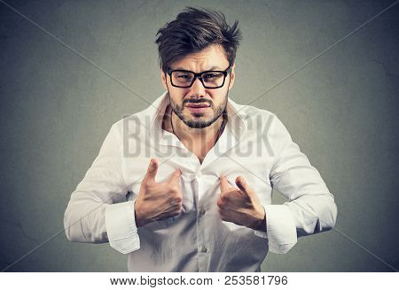 Young Angry Man In Glasses And White Shirt Pointing At Himself Looking Offended And Insulted At Came