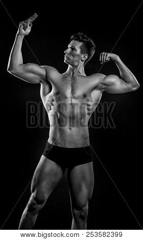 Sportsman. Muscular Sportsman With Six Pack, Black And White. Sportsman Bodybuilder Point On His Mus