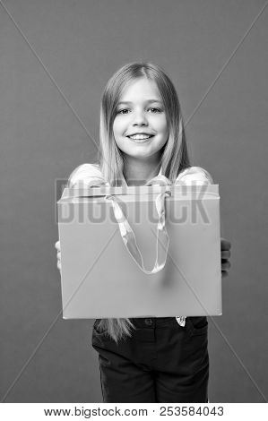 Girl Likes To Buy Fashionable Clothes In Shopping Mall. Girl On Smiling Face Carries Shopping Bag, I