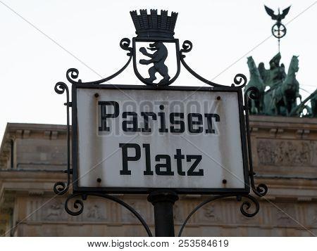 Street Sign Pariser Platz With The Quadriga Of Brandenburg Gate In Background, Selected Focus
