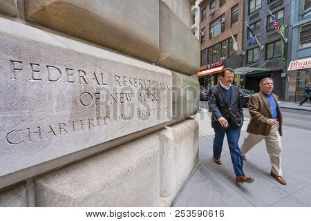 New York, Usa - May 8, 2018: Man Walking Past The Federal Reserve Bank Of New York. It Is Responsibl