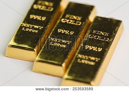 Gold bar bullions ingot, selective focus, crisis safe haven for investment or reserve for country economics. poster