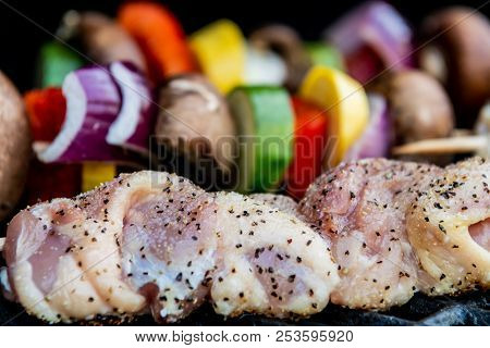 Seasoned Chicken Kabobs Grilling In Front Of Veggie Kabobs