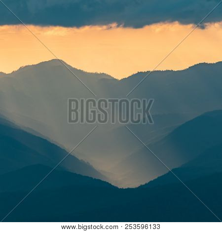 Soft Sunset Light Falls Over The Blue Ridge With Rays Of Sun