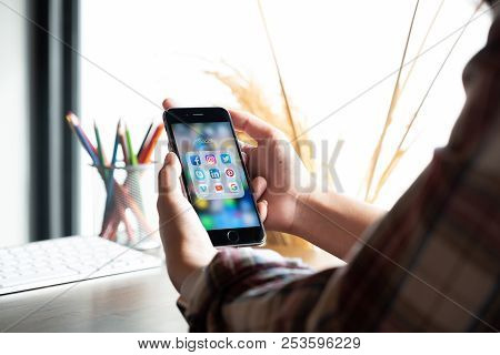 Chiang Mai, Thailand - Jun 30, 2018: Hand Of Man Using Iphone 6S With Icons Of Social Media On Scree