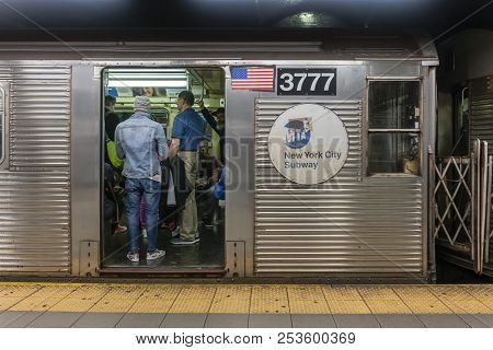 New York, Usa - May 11, 2018: Passengers Travelling On A Subway Train In New York City. The Subway I