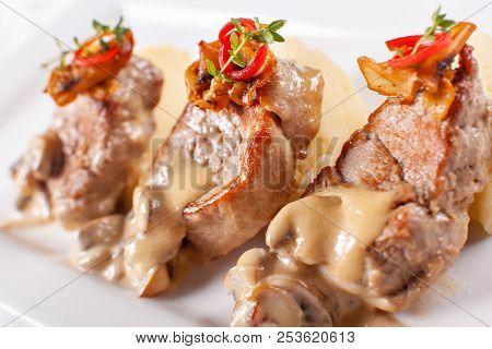 Pork Medallions with Mashed Potato and Mushrooms. Pork tenderloin on a white plate, good serving. restaurant menu poster