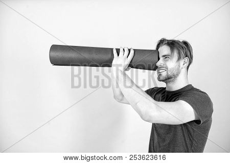 Man Spy In Yoga Mat As Telescope. Fashion Athlete In Blue Tshirt And Shorts. Sportsman With Stylish