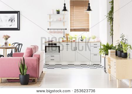 Real Photo Of Open Space Kitchen Interior With Checkerboard Floor, Window With Wooden Blinds, Pink V