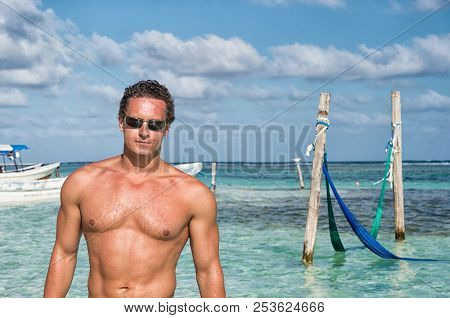 Man On Sea Beach In Costa Maya, Mexico. Sexy Man With Muscular Torso Enjoy Sunny Day On Caribbean Be