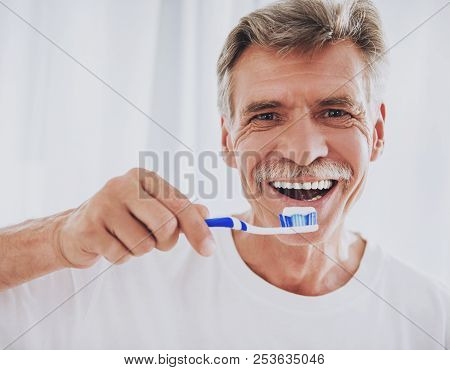 Close Up. Senior Man Brushing Teeth In Bathroom. Morning Routine. Healthcare Roncepts. Elder Person