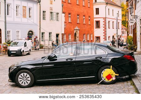 Wheel Of Car Was Locked With Yellow Clamped Wheel Lock By Traffic Police