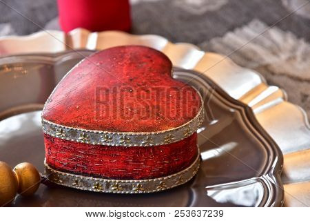 Box For The Valuables Of The Form Of The Red Heart On The Table
