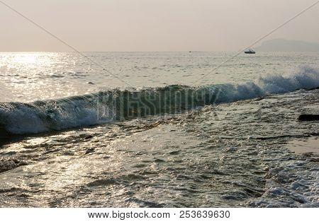 Sea Wave At Sunset, The Sea Coast, The Coast Of Turkey, The Mediterranean Sea