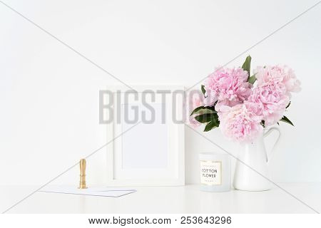 Stylish White A5 Blank Frame Mockup. Still Life Composition, Floral Bouquet Of Pink Peonies In Jug,