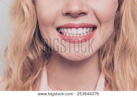 Crop Close Up Portrait Half Face Of Woman With Blond Hair And Shiny Beaming Smile While Being At The