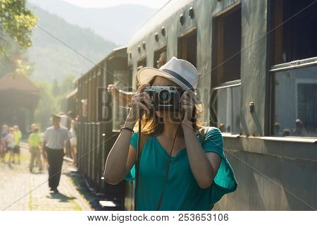 Traveler Girl Taking Photo In Train Station. Girl Traveling Alone In Train Station Taking Photo. Tra