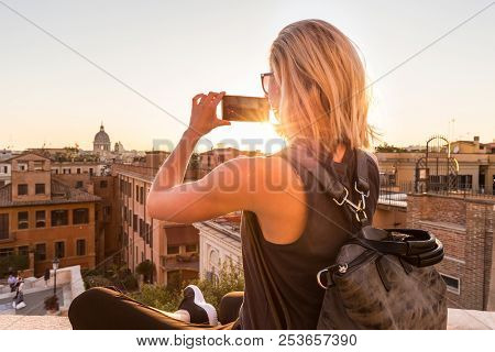 Female Tourist Taking Mobile Phone Photo Of Piazza Di Spagna, Landmark Square With Spanish Steps In