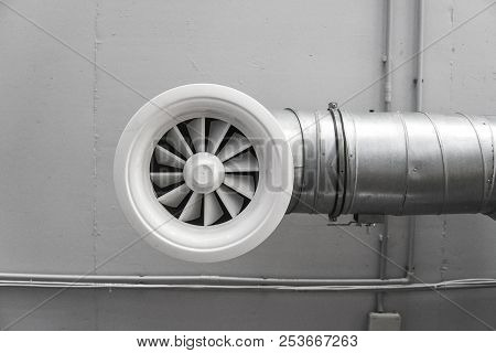Ventilation System On The Ceiling Of Large Buildings. Ventilation Pipes In Silver Insulation Materia