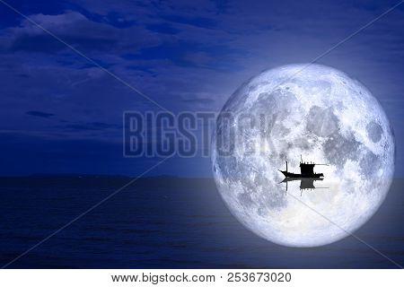 Full Moon Back Silhouette Boat On Night Sea