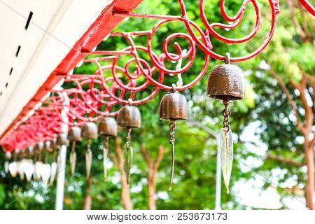 Hanging Bells On Red Wire Design And Water Drop Of Rain Fall Forest Hill Background