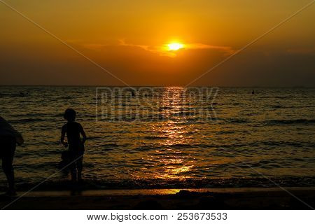 Silhouette Woman Run Away From Kid To Beach And Sunset