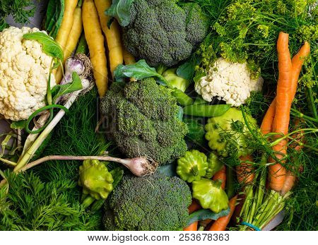 Different Mixed Colorful Health Vegetables On The Table, Carrot, Cucumber, Green Pea, Cauliflower, B