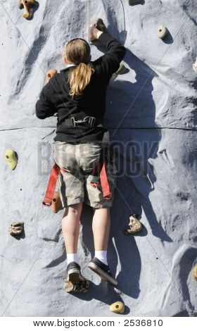 Girl Climbing Artifical Climbing Wall