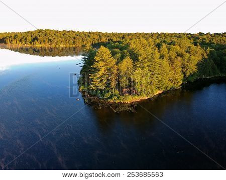 Aerial Drone View Of Lean To Campsite At The End Of A Pennisula In The Adirondack Mountain Wildernes