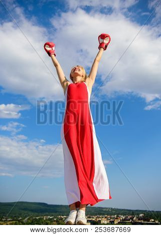 Femininity And Strength Balance. Woman Red Dress And Boxing Gloves Enjoy Victory. She Fighter Female