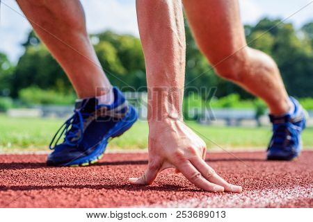Runner Ready To Go Close Up. Ready Steady Go Concept. At Beginning Of Great Sport Career. Hand Touch