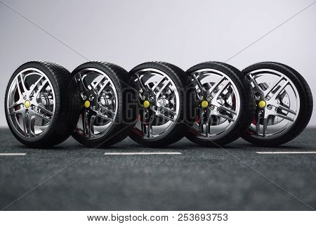 Car Wheel, Car Tire Standing On A Road. Concept Tyres. Car Tire With A Disc Standing On The Asphalt