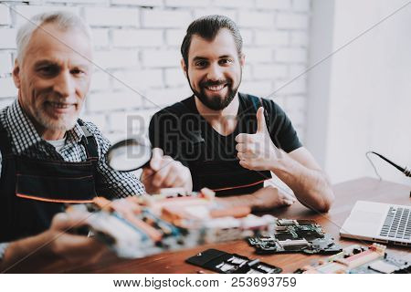 Two Men Repairing Hardware Equipment From Pc. Repair Shop. Worker With Tools. Computer Hardware. You
