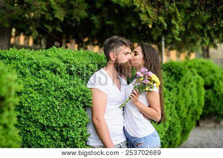 Man Bearded Hipster Hugs Gorgeous Girlfriend. Couple Love Romantic Date Walk Nature Park Background.