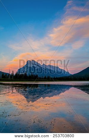 Sunset Colours Reflecting Around Mount Rundle In Vermillion Lakes