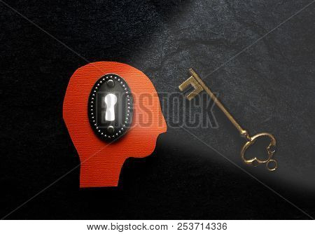 Head With Bright Keyhole Next To A Vintage Lock