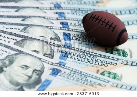 Souvenir Ball For Playing Rugby Or American Football On Us Banknotes. The Concept Of Corruption Or S