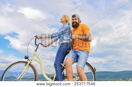 Man And Woman Spend Active Leisure With Bike. Couple In Love Date Outdoors Cycling. Bike Rental Or B