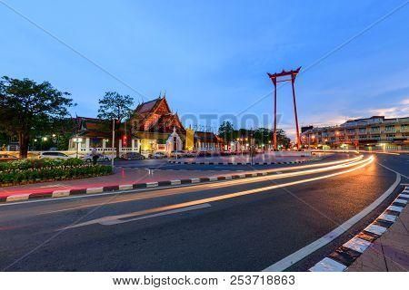 Giant Swing Landmark Of Bangkok City In Sunset Time With Lighting Trail Traffic  / Sao Ching Cha Lan