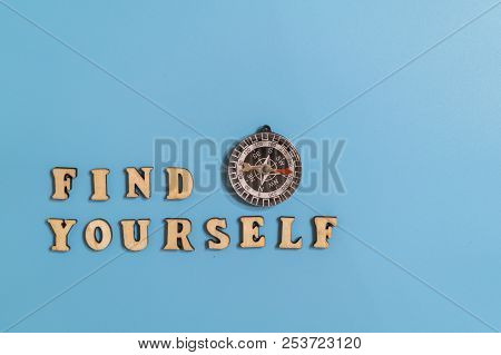 Inscription Find Yourself And Compass On A Blue Background. Concept Of Asserting Oneself In Life And