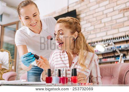 Jovial Mature Woman Adoring New Nail Polish