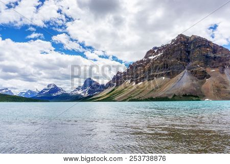 Bow Lake And Crowfoot Mountain In Banff National Park, With Crowfoot Glacier In The Background. Loca