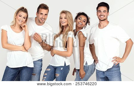Group Of Young Multi-ethnic Attractive People Wearing White Shirts, Smiling And Having Fun Together,