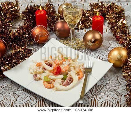 a fresh seafood salad on christmas table poster